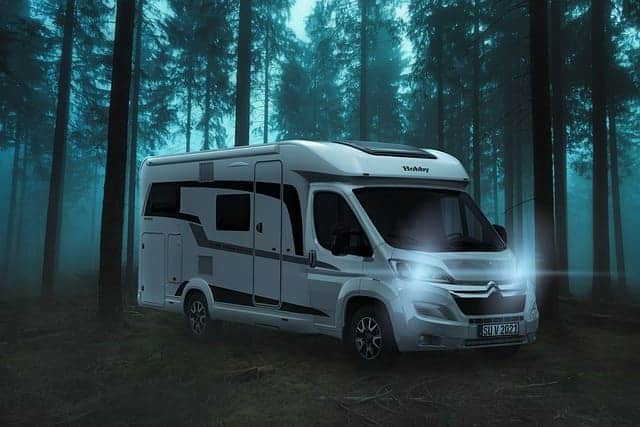 RV inside the deep forest looking for antenna signals to watch tv