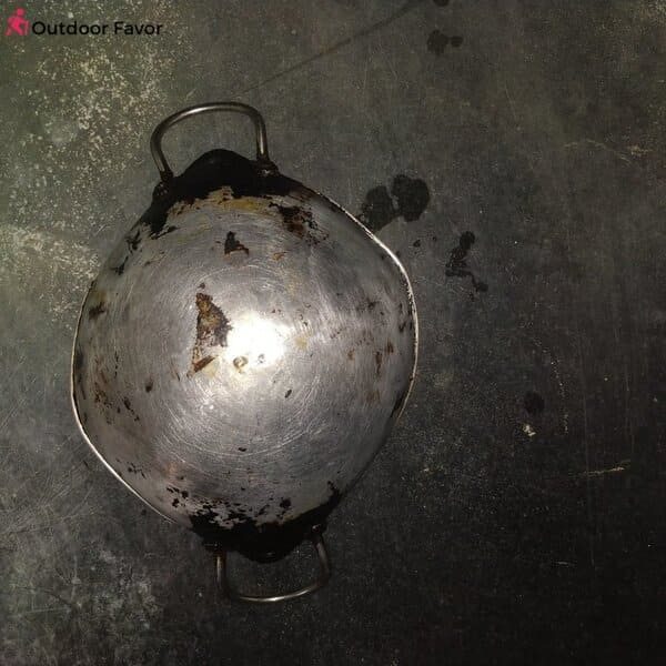cheaply made cookware result in black coating when cooking
